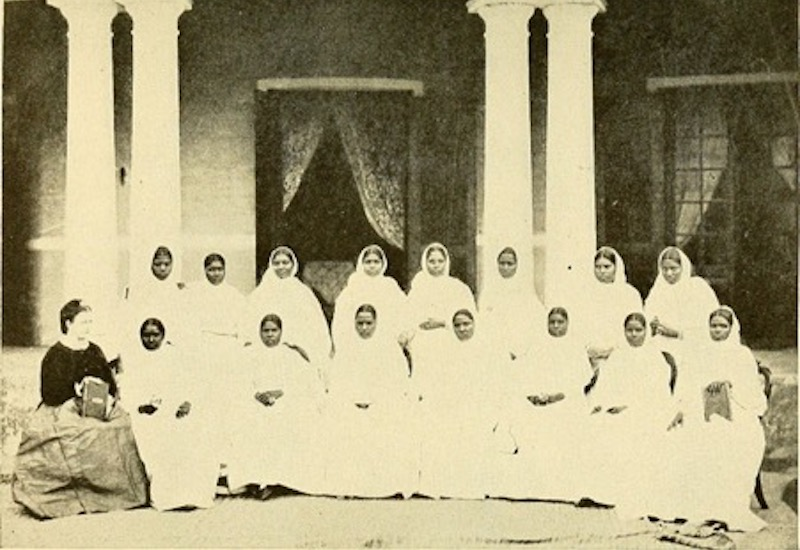 Photo of a missionary and students by Swain, C., A Glimpse of India.